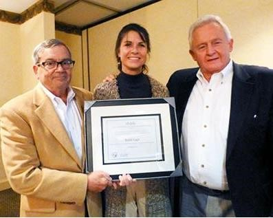 """Wendy was the inaugural recipient of the Marc King """"Long-Term Leadership Award"""" in October 2013. Pictured with SBTDC State Director Scott Daugherty (l) and former SBTDC Operations Director Marc King (r)."""