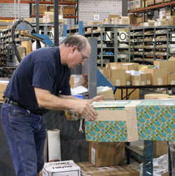 photo of crossco employee preparing a shipment